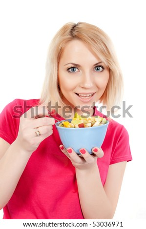 young woman eating a tasty fruit salad