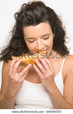 Young woman eating cantaloupe