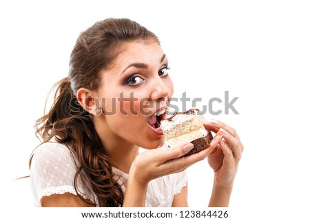 Young woman eating delicious piece of cake - stock photo