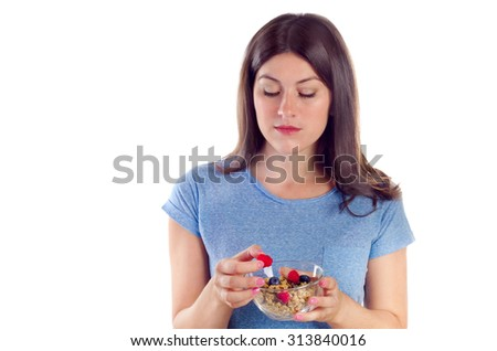 Young woman eating healthy breakfast isolated on white background