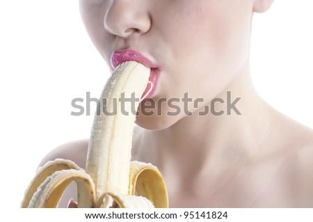 Young woman eating peeled banana - stock photo
