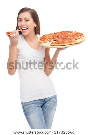 Young woman eating pizza - stock photo