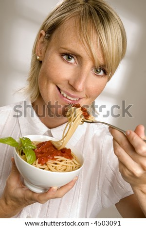 young woman Eating spaghetti close up shoot - stock photo