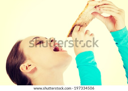 Young woman eating tasty pizza. - stock photo