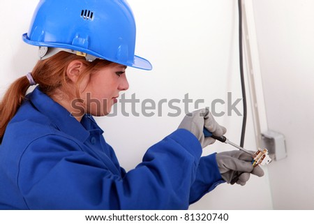 Young woman electrician