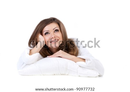 Young woman embracing her pillow in the morning isolated on white background - stock photo