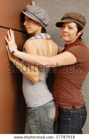 young woman embracing outdoor - stock photo