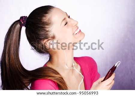 young woman enjoy in music