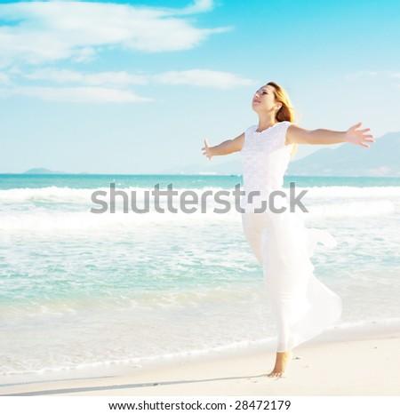 Young woman enjoy sun near ocean - stock photo