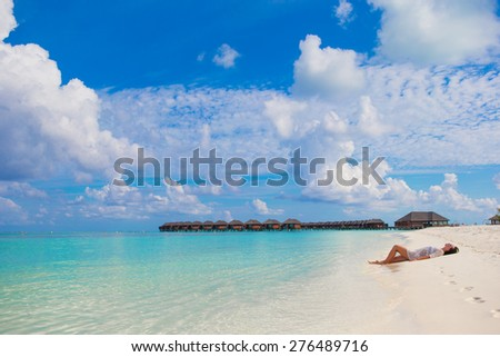 Young woman enjoy tropical beach vacation - stock photo