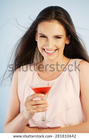 Young woman enjoying a cocktail - stock photo