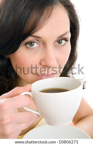 young woman enjoying a cup of tea - stock photo