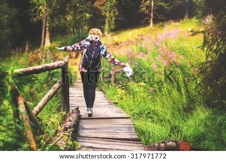Young woman enjoying a hike through the forest.