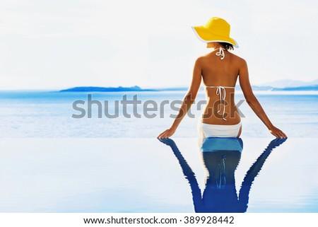 Young woman enjoying a sun - stock photo