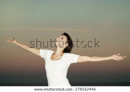 young woman enjoying a walk in the fresh air - stock photo