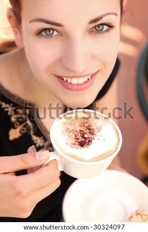 Young woman enjoying coffee break - stock photo