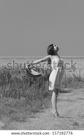 Young woman enjoying her pregnancy in the countryside