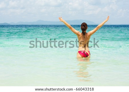 Young woman enjoying her vacation - stock photo