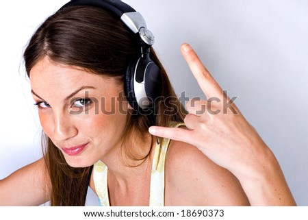 Young woman enjoying music and moving to the beat