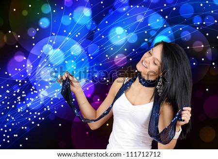 Young woman enjoying music, having fun and dancing at a club with her eyes closed, perfect for youth lifestyle, party or other celebration. - stock photo