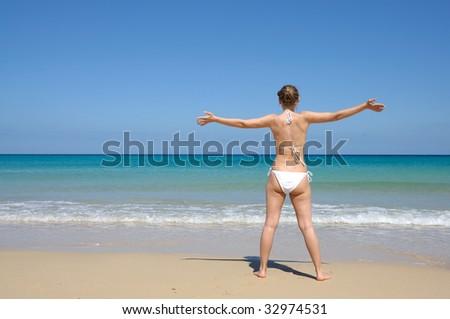 Young woman enjoying the beach, Fuerteventura Spain - stock photo