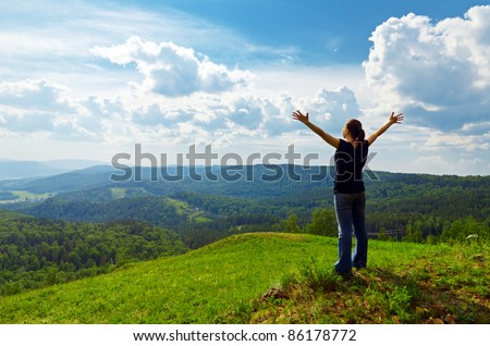 Young woman enjoying the fresh air. - stock photo