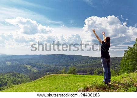 Young woman enjoying the fresh air. - stock photo