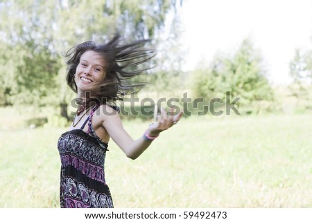 Young woman enjoying the nature. Lots of copy space. - stock photo