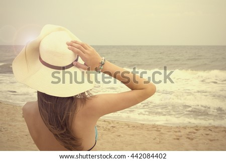 Young woman enjoying the ocean view in a summer vacation. - stock photo