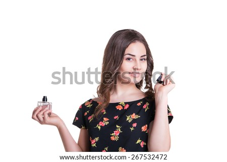 young woman enjoying the smell of the perfume  - stock photo
