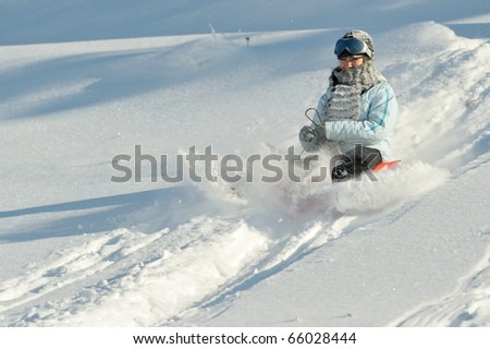 young woman enjoying the snow
