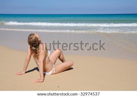 Young woman enjoying tropical beach. Fuerteventura, Canary Islands, Spain - stock photo