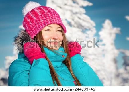 young woman enjoying winter - stock photo