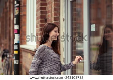 Young Woman Entering Urban Building Through Stock Photo Royalty