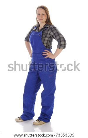 Young woman (Erin Crafts, DIY designer, trainee) with long blond hair wearing a plaid shirt and a blue work overalls. Isolated against a white background. - stock photo
