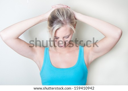Young woman exercise her neck muscles in physical Therapy - stock photo