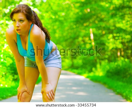 Young woman exercising, from a complete series of photos. - stock photo