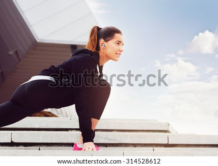 Young woman exercising in urban environment  - stock photo