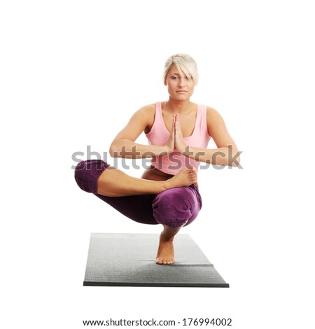 Young woman exercising isolated on white background - stock photo