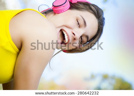 Young woman exercising outdoors with headphones - stock photo