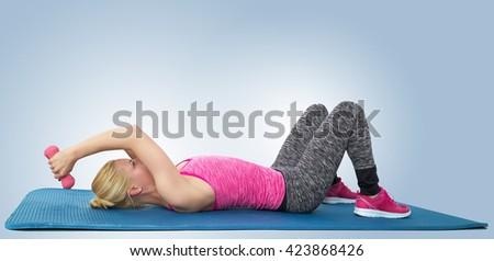 Young woman exercising to lose some leftover baby weight - stock photo
