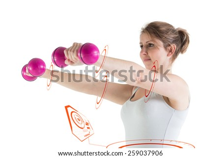 Young woman exercising with dumbbells against fitness interface - stock photo