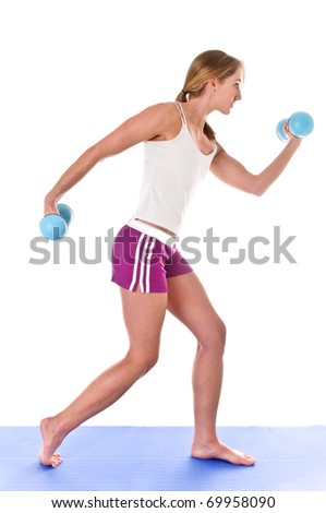 Young Woman Exercising with Hand Weights - stock photo