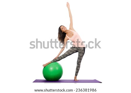 Young woman exercising with swiss ball - stock photo