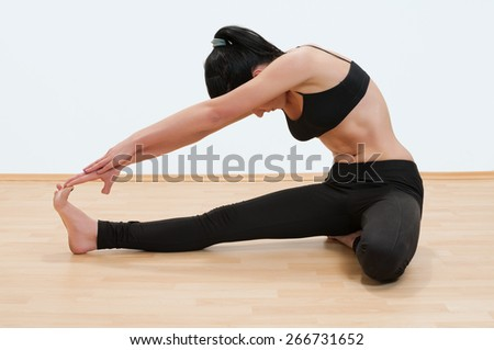 Young woman exercising yoga
