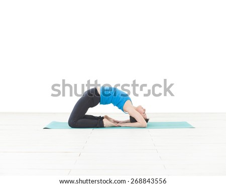 Young woman exercising yoga isolated on white - stock photo