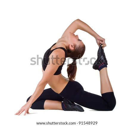 Young woman exercising yoga, isolated on white background - stock photo
