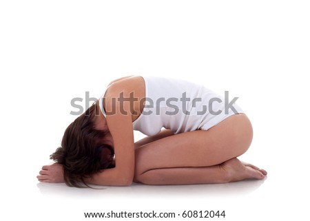 Young woman exercising yoga on a white background - stock photo