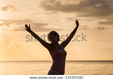 Young woman experiencing freedom - stock photo