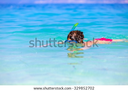 Young woman exploring the underwater world in the Mediterranean sea with snorkeling gear. - stock photo